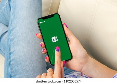 Sankt-Petersburg, Russia, May 30, 2018: Microsoft Exel application icon on Apple iPhone X screen close-up in woman hands. Microsoft office Exel app icon. Microsoft office on mobile phone. Social media