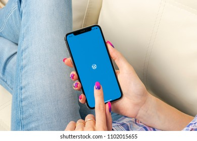 Sankt-Petersburg, Russia, May 30, 2018: Wordpress application icon on Apple iPhone X screen close-up in woman hands. Wordpress app icon. Wordpress.com application. Social network