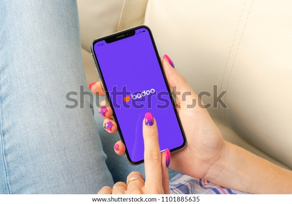 Sankt-Petersburg, Russia, May 30, 2018: Badoo application icon on Apple iPhone X screen in woman hands. Badoo app icon. Badoo is an online social media network. Social media app