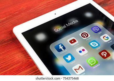 Sankt-Petersburg Russia November 13, 2017: Apple iPad Pro on wooden table with icons of social media facebook, instagram, twitter, snapchat application on screen. Tablet Starting social media app.