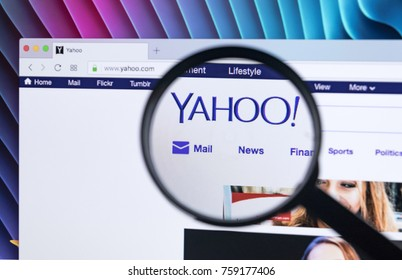 Sankt-Petersburg, Russia, November 21, 2017: Yahoo homepage website on iMac monitor screen under a magnifying glass. Yahoo is a multinational Internet corporation with search engine Yahoo Search.
