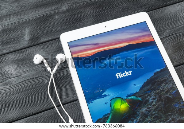 Sankt-Petersburg, Russia, November 23 2017:  Apple iPad Pro with Flickr homepage on monitor screen. Flickr is the video hosting network website. Homepage of Flickr.com on tablet computer.
