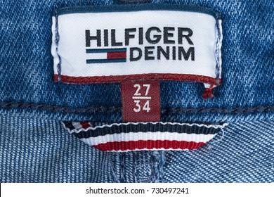 Sankt-petersburg, Russia, October 9, 2017: Closeup of Tommy Hilfiger label on blue jeans. Tommy Hilfiger is lifestyle brand. Hilfiger Denim. Tommy Hilfiger blue jeans detail