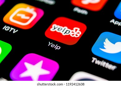 Sankt-Petersburg, Russia, September 30, 2018: Yelp application icon on Apple iPhone X screen close-up. Yelp app icon. Yelp.com application. Social network. Social media