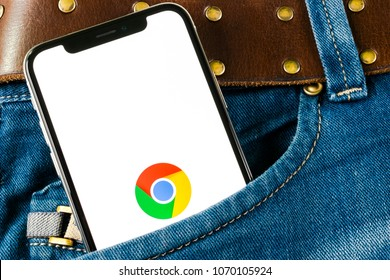 Sankt-Petersburg, Russia,April 14, 2018: Google Chrome application icon on Apple iPhone X screen close-up in jeans pocket. Google Chrome app icon. Google Chrome application. Social media network