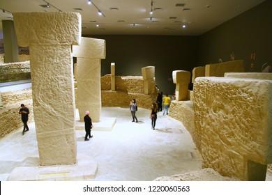 SANLIURFA MUSEUM, SANLIURFA, TURKEY - 20 October 2018. A view from the gallery of the replica pillars of Gobeklitepe in Sanliurfa Museum.