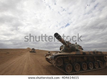 SANLIURFA, TURKEY, 13 SEPTEMBER 2014 Turkish soldier and armored vehicle waiting at the Turkey - Syria border around Kobani district.