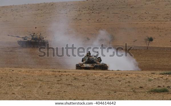 SANLIURFA, TURKEY, 13 SEPTEMBER 2014 Turkish soldier and armored vehicle waiting at the Turkey - Syria border around Kobani district.