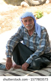 Sanliurfa / Turkey - 23 October, 2007: Portrait of an elderly man living in Turkey's Syrian border city of Urfa. He has a traditional blue accessory on his head. Horizontal close-up.