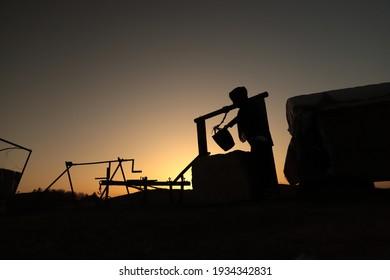 Sanliurfa, Turkey. March 2021. Harran neighborhood. Daily life in Urfa. Silhouette of people at sunset