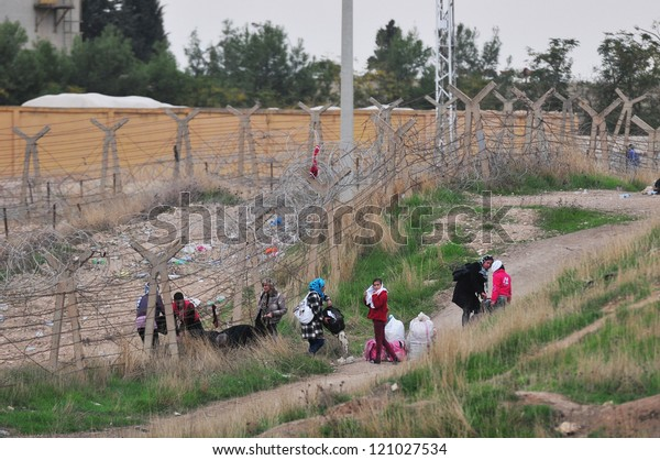 SANLIURFA, TURKEY - NOVEMBER 18: Syrian who have fled the war at home, entered Turkey from the border on November 18, 2012 in Sanliurfa, Turkey.