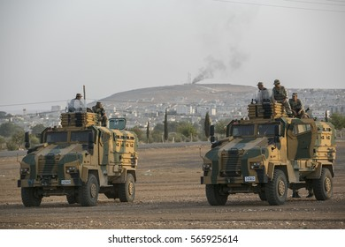 Sanliurfa Turkey October 03, 2014 An explosion after an apparent US-led coalition airstrike on Kobane, Syria, as seen from the Turkish side of the border, near Suruc district,