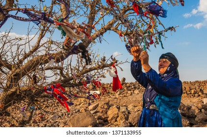 SANLIURFA, TURKEY- OCTOBER 23, 2016: In Sanliurfa, it is a tradition to hold a cloth and make wishes to trees.