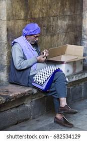 SANLIURFA, TURKEY - OCTOBER 29, 2013: Local man rolls his cigarette, in Sanliurfa, Turkey.