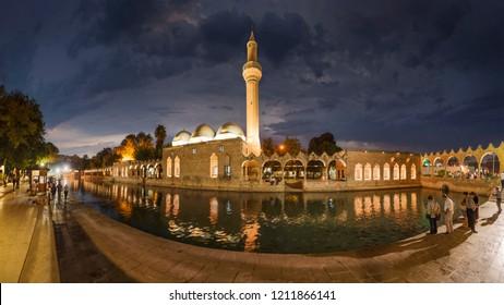 SANLIURFA, TURKEY - SEPTEMBER 14, 2018: people at Balikligol, Halilurrahman Mosque Sanliurfa