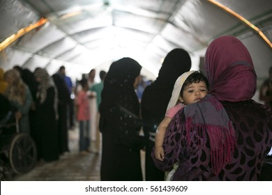 Sanliurfa Turkey September 23,2015 Mother and child in Akcakale Refugee Camp. Approximately 28.000 Syrian people reside in Akcakale Tent Camp in Urfa.