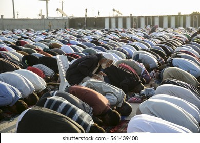 Sanliurfa Turkey September 24,2015 Refugees praying together at sunset in Akcakale Refugee Camp. Approximately 28.000 Syrian people reside in Akcakale Tent Camp in Urfa.