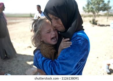 SANLIURFA,TURKEY, 18 FEBRUARY 2015 Syrian refugees walking on Turkey-Syria border in Suruc district.