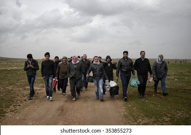 SANLIURFA,TURKEY, 18 FEBRUARY 2015 Syrian refugees walking on Turkey-Syria border in Suruc district.