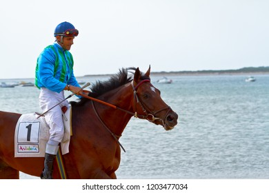 SANLUCAR DE BARRAMEDA, CADIZ, SPAIN - AUGUST 11: Unidentified rider at the start of race horses on Sanlucar de Barrameda beach on August 11, 2011 in Sanlucar de Barrameda, Cadiz, Spain.