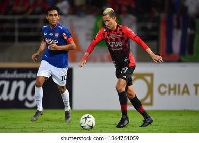 Sanrawat Dechmitr no.29(red)of Bangkok United in action during The Football Thai League between Bangkok United and SCG Muangthong United at True Stadium on March 02,2019 in Pathum Thani, Thailand