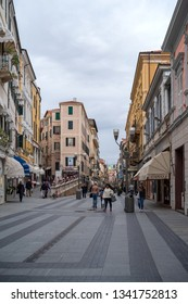 Sanremo, Italy - April 9, 2018: Pedestrian main street G.Matteotti in the old town of Sanremo, seaside city on the Italian Riviera