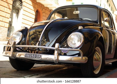 SANREMO, ITALY - MARCH 14: Closeup of a Volkswagen Beetle cruising on the road in Sanremo, Italy on March 14, 2010.