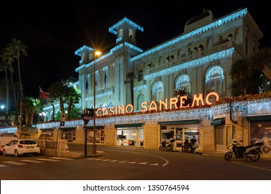 Sanremo, Italy - March 19, 2019: Facade view by night of the Municipal Casino in Sanremo, built in 1905, is an example of liberty style building