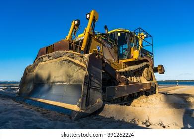 Sans Souci, NSW, Australia - 18 Jun, 2014: Caterpillar Dozer multi terrain loader on the Sans Souci beach