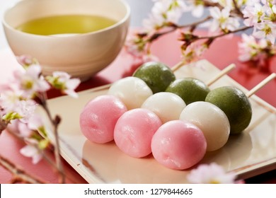 Sanshoku Dango (Three Colored Dumplings) and japanese tea, Cherry-blossom viewing image.