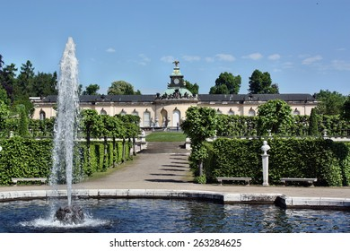 Sanssouci, Potsdam, Germany - May 19, 2013: The fountain in the background of the palace Bildergalerie. Sanssouci is the most famous palace of Frederick the Great