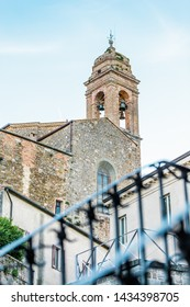 Sant' Agostino Church and bell tower of Palazzo dei Priori in Montalcino town, Tuscany, Italy, erected by the Augustinian order in 1227. Montalcino is known for its Brunello di Montalcino wine.