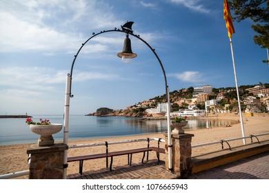 SANT FELIU DE GUIXOLS,SPAIN-MAY 29,2012: Mediterranean beach and maritime promenade, Sant Feliu de Guixols,Costa Brava,Catalonia.