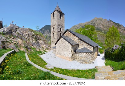 Sant Joan de Boi church in Valley of Boi, composed of the bell tower of Lombard style and three naves covered with stone hedge.  Lleida, Spain, UNESCO world heritage site.