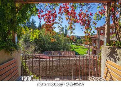 Sant Joan de les Abadesses, Catalonia, Spain. Balcony park garden with flowers, autumn day.