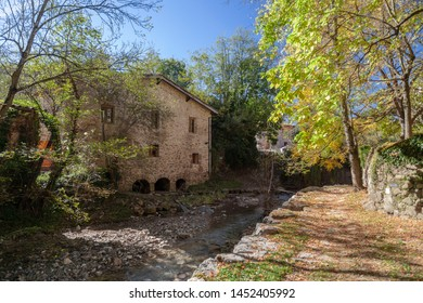 Sant Joan de les Abadesses, Catalonia, Spain. Old windmill close to river.
