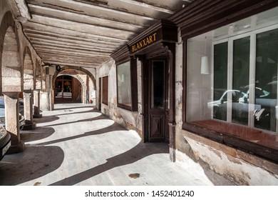 SANT JOAN DE LES ABADESSES,SPAIN- OCTOBER 25,2018: Old arcades in main square village.