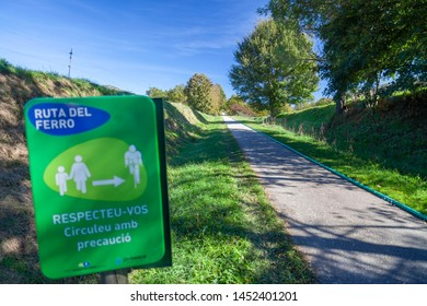SANT JOAN DE LES ABADESSES,SPAIN-OCTOBER 25,2018:Ruta del Ferro, Iron and Coal Route, Old railway transformed in trail walk or bike ride. Villages of Sant Joan de les Abadesses and Ripoll