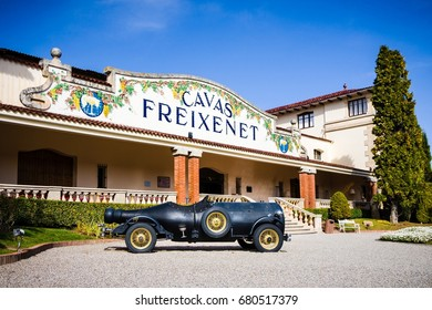 SANT SADURNI - FEBRUARY 29: A car in a shape of wine bottle parked at the entrance to Freixenet headquarters on February 29, 2016, in Sant Sadurni, Spain. Freixenet is Spanish wine producer.