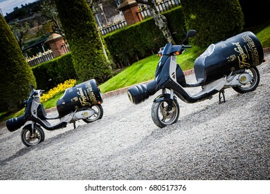 SANT SADURNI - FEBRUARY 29: Scooters in a shape of wine bottle parked at the entrance to Freixenet headquarters on February 29, 2016 in Sant Sadurni, Spain. Freixenet is Spanish wine producer.