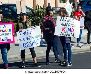 Santa Ana, California - January 20, 2018: Woman holding an anti-Trump sign at the 2018 Women's March in Santa Ana. In hundreds of cities, towns and suburbs in the United States people marched.