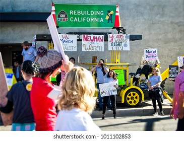 Santa Ana, California - January 20, 2018: Women speaking out and holding signs  at the 2018 Women's March in Santa Ana. In hundreds of cities, towns and suburbs in the United States people marched.