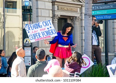 Santa Ana, California - January 20, 2018: Woman dressed as Super Girl holds a signs at the 2018 Women's March. In hundreds of cities, towns and suburbs in the United States people marched.