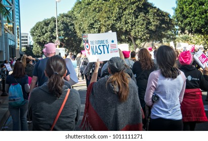Santa Ana, California - January 20, 2018: Marchers holding political and equality signs at the 2018 Women's March. In hundreds of cities, towns and suburbs in the United States people marched.