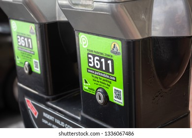 Santa Ana, California/United States - 03/10/19: A closeup of a pair of parking meters with zone numbers for the parking app known as ParkMobile, or Park Mobile, for convenient payment