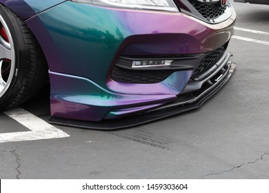 Santa Ana, California/United States - 06/08/19: A sports car that has lowered suspension, where the bumper is closer to the pavement, located at a car show