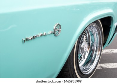 Santa Ana, California/United States - 06/08/19: A name plate sign on the fender of a vintage Chevrolet Impala vehicle