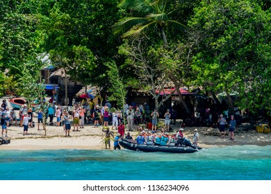 Santa Ana I, Solomon Islands - February 20 2017: Zodiacs landing on the beach at Santa Ana are greeted by mock challenge from war-painted warriors, before being invited into the village.