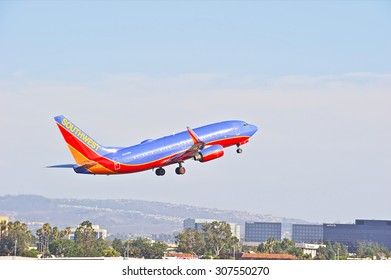 SANTA ANA/CALIFORNIA - AUG. 17, 2015: Southwest Airlines Boeing 737-700 commercial jet departs from John Wayne International Airport in Santa Ana, California, USA
