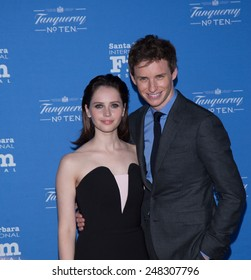 SANTA BARBARA, CA - JANUARY 29, 2015: Felicity Jones and Eddie Redmayne (in A Theory of Everything) on the red carpet for its screening at the 30th Santa Barbara International Film Festival #SBIFF